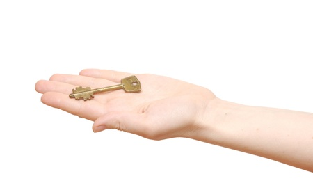 old key in hand woman isolated on white background Stock Photo - 9470042