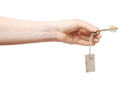 Hand and key with blank label isolated on white background Stock Photo - 9470047