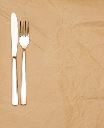 knife and fork on old paper. space for the text Stock Photo - 9597680
