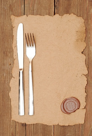 cafe menu: knife and fork on old paper. space for the text Stock Photo