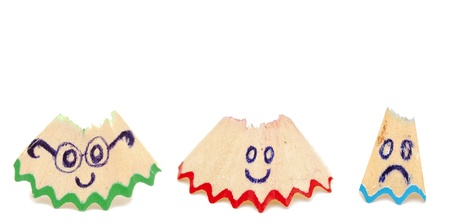 group of pencil shavings with smile on white photo
