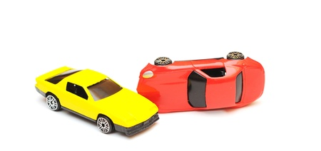 toy car accident. cars in crash isolated on white photo