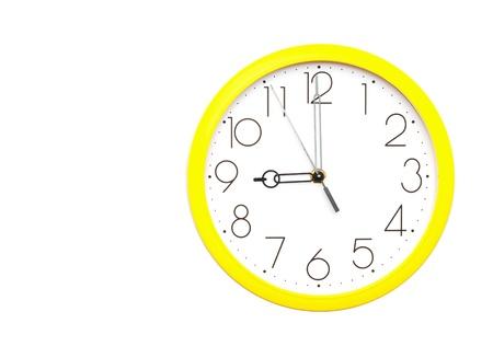 yellow wall clock on white photo