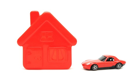a house and car toy isolated on white photo