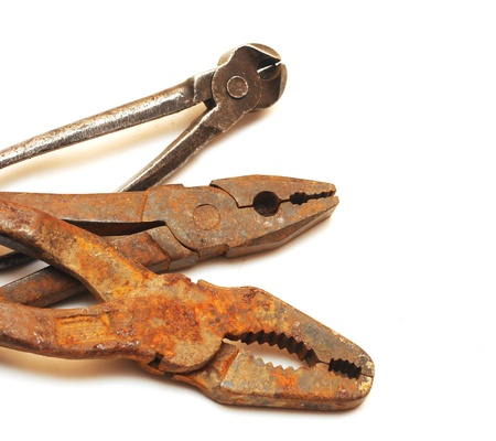 Old rusty pliers on a plain white background  photo
