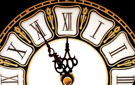 past midnight: Old clock with roman numbers Stock Photo