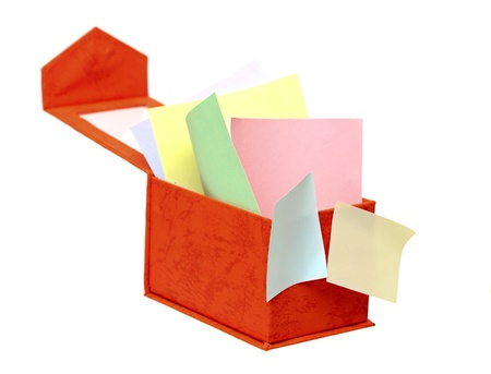 Open box with color reminder notes on a white background. photo