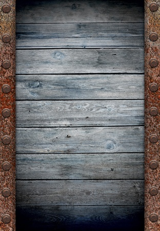 old wooden wall in rusty metal frame texture  photo