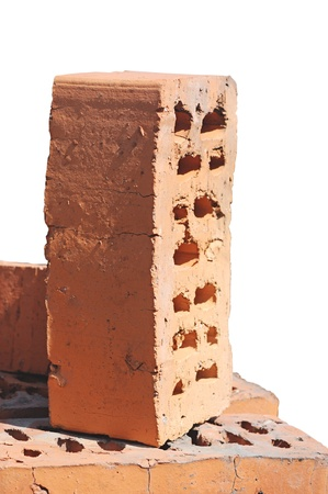 Stack of red bricks over white background  photo