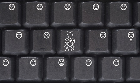 Computer keyboard closeup with smiley buttons  photo