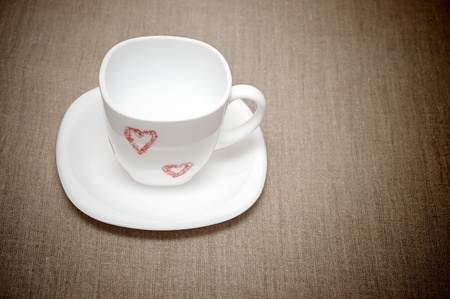 bagging: empty white cup on bagging  Stock Photo