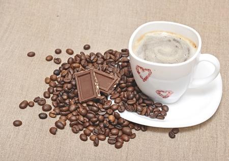 mug coffee and coffee beans on bagging Stock Photo - 10503085