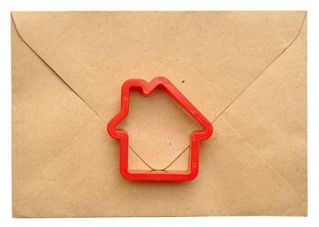 toy house on the sealed envelope Stock Photo - 10623661