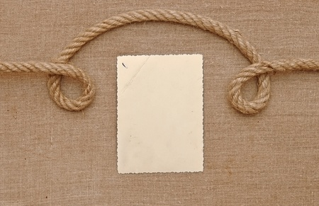 Old vintage photo with a rope on brown canvas background photo
