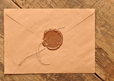 sealed brown envelope on wood background Stock Photo - 10713261