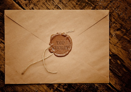 seal brown: Mail envelope with a stamp top secret