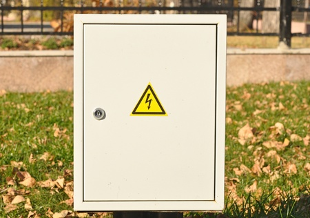 fusebox: Fuse box with blackyellow sign warning for risk of electrocution  Stock Photo