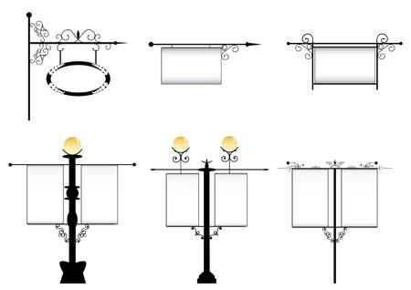 lampposts: hierro forjado farolas con un cartel de publicidad