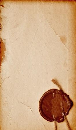 Antiguo papel con un sello de cera Foto de archivo