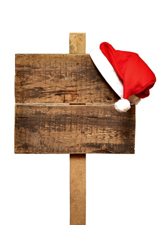 wooden road sign with Santas hat  isolated on a white background  photo