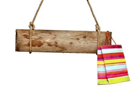 wooden signboard with shopping bag isolated on white photo