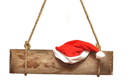 wooden signboard with Santa's hat  isolated on a white background  photo