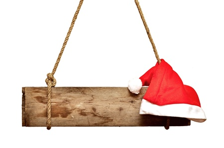 old wooden signboard with Santa's hat isolated on a white background Stock Photo - 11072471