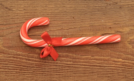 Candy canes on old vintage wood table  photo