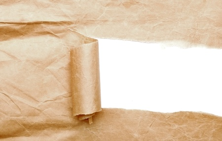 reveal: Brown package paper torn to reveal white panel ideal for copy space