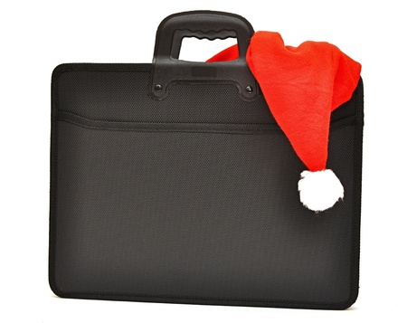 Black business briefcase with Santas hat isolated on a white background photo