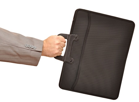 Close-up of businessman hand holding with briefcase photo