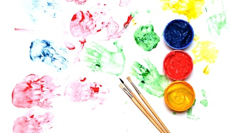 Paint brushes with opened paint buckets  photo