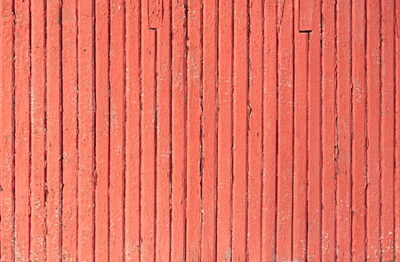 chipped: An old worn barn or antique wooden fence with chipped red paint.