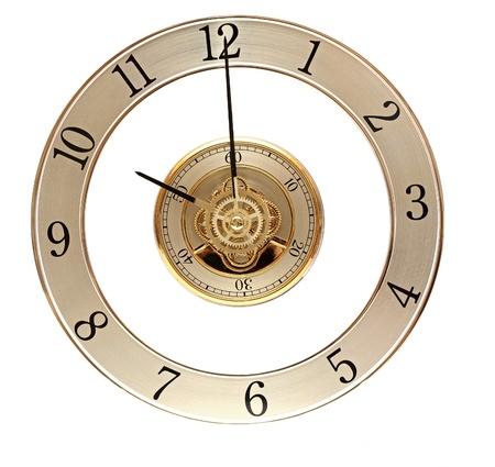 reloj antiguo: Reloj de oro con engranajes en blanco