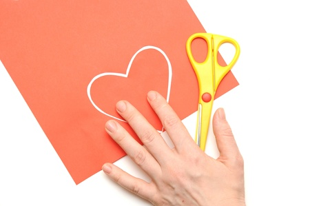 Red valentine heart and yellow scissor photo