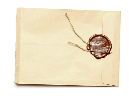 red wax seal on yellow envelope. Secret, security concept.  photo