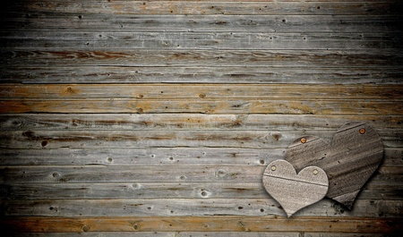 two heart on wood background with copy space