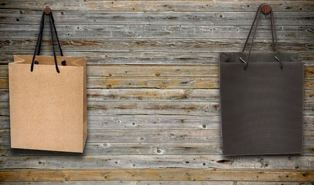 shopping bags hang on wooden wall photo