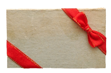 old paper sales tag and label with red ribbon and bow on white background Stock Photo - 12232441