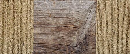 ropes borders on weathered wood background  Stock Photo - 12232450