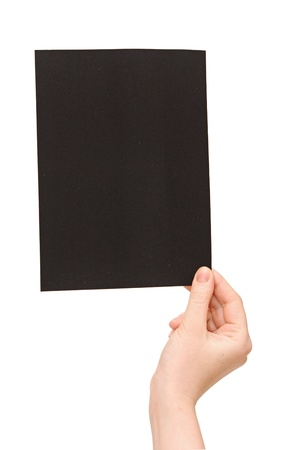 Hands holding up black paper isolated on white background  photo