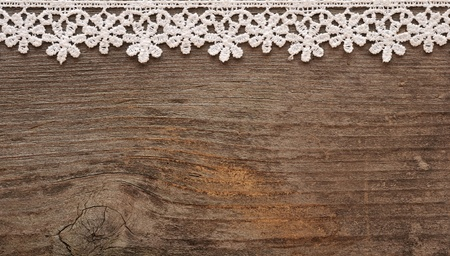 wooden background with white lace frame  Stock Photo