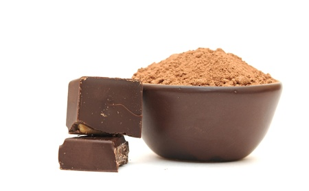 cocoa powder  in a clay bowl and broken chocolate bar  on a white background photo