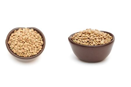 green lentil: green lentil in round brown cup on white background
