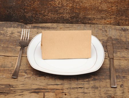 Empty dish, knife and fork on wood table  Stock Photo - 12865088