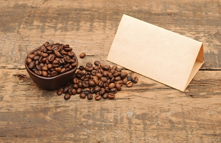 old paper for recipes and coffee beans on wooden table photo
