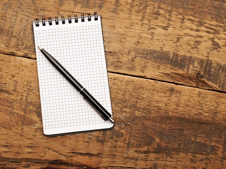 Blank note paper with pen on wood background Stock Photo - 13211394