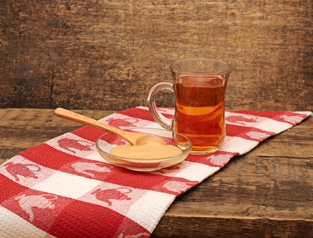 tea and honey on wooden background photo
