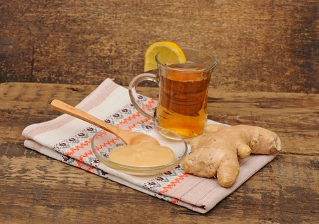 glass of ginger tea with honey and lemon - tea time  photo