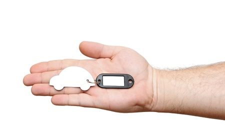 human hands holding model car with blank tag isolated on white background photo